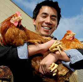 Founder Dennis Mao holding chickens